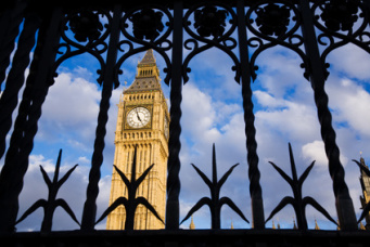 Big Ben seen through the ornate metal security gates, Westminster, UK