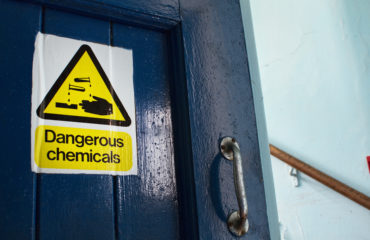 Dangerous Chemicals sticker on door